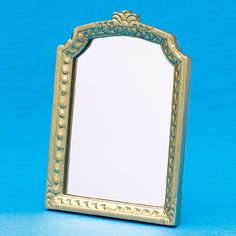 Ornate large mantel mirror in a gold-finish. 93 x 65 x 6mm from The Dolls House Emporium