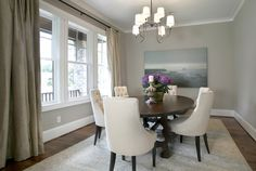 I LOVE this small dining room. Suzie: Ashley Goforth Design - Gorgeous transitional gray & blue dining room design with soft ...