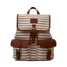 Pequeña mochila de piel cuero y lona, estupenda para llevar tus accesorios en estos días de playa.