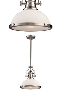 For sublime style, illuminate your home with the Elk Lighting Chadwick Satin Nickel One-Light Pendant with Frosted Glass. With a design that is made to capture the essence of contemporary taste, this one-light pendant features a satin nickel finish that accentuates its bold appearance. With stems of 6 and 12 inches that make it versatile and allow placement in the study room, living room and the dining room, plus a frosted glass shade that accents the light, this piece provides warm and…