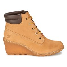 @timberland is on top of the wedge ankle boot trend this season, reworking their classic yellow boot into a cute, feminine bootie! #shoes #boots #booties #wedges #ankleboots #yellowboot #womens #fashion #trends #autumn