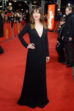 Dakota Johnson in a plunging black Dior gown at the premiere of Fifty Shades of Grey at the Berlin Film Festival. See all of the actress's best looks.