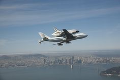 The space shuttle Endeavour atop NASA's modified 747 carrier fly over Bay Bridge that connects San Francisco to Oakland, CA during its Tour of California, the last leg of its final ferry flight into history. After low-altitude flyovers of Sacramento, San Francisco, Los Angeles and numerous other communities and landmarks, the flight would conclude at Los Angeles International Airport where Endeavour would be turned over to the California Science Center for permanent exhibit, September 21…