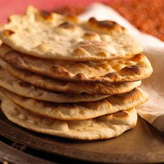 If you're a fan of Indian food, you need to learn how to make naan, that delicious flatbread that's literally made for sopping up the bold, flavorful sauces common in Indian cuisine. Easy Indian Recipes, Ethnic Recipes, Recipes With Naan Bread, Flatbread Recipes, Vegetarian Recipes, Cooking Recipes, Tortillas, Crackers, Yummy Food