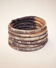 Indonesia | Bracelets (Maja Phite) from Irian Jaya | Shell and fibre