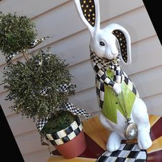 Alice in Wonderland tall white rabbit statue with Mackenzie Childs bow and black and white checked jacket.