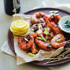 Our grilled prawns make for a light bite with plenty of herbs, olives and a little bit of chilli. Drizzle them with our life-changing coriander dressing. Grilled Prawns, Onion Relish, Red Chilli, Lemon Slice, Lemon Grass, Coriander, Cooking Time, Chicken Wings, A Food