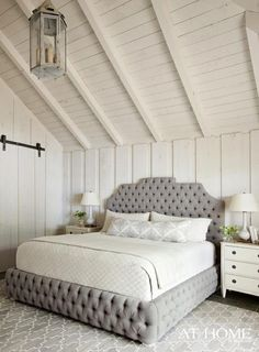 white plank walls   ceiling, gray tufted bed, lattice rug