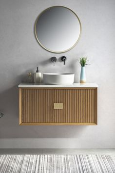 The Finola range of stunning contemporary wall hung vanities will surely make a statement in any master bathroom or ensuite. The unit features an easy to clean white Quartz top and solid wood cabinet. #bathroomvanity #wallhungvanity #contemporarybathrooms #bathroomdesign #modernbathrooms #midcentury #schotshomeemporium #schots