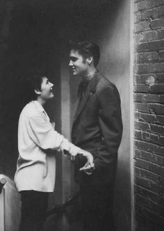 Elvis Presley and a fan backstage, 1956.
