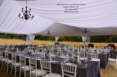 These black chandeliers really POP against this white tent liner! How gorgeous! #tentwedding #virginiawedding #outdoorwedding #outdoorreception