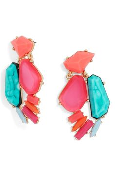 Oversized neon crystals in an edgy, asymmetrical cluster add bold disco style to these eye-catching drop earrings.