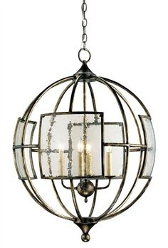 The globe shape wrought iron frame with seeded glass makes this chandelier an eye-catching accent to a space. The Pyrite bronze finish provi...