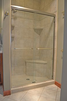 Basco frameless sliding shower doors on a tiled opening. & Basco frameless sliding shower doors on a tub with Vessence glass ...