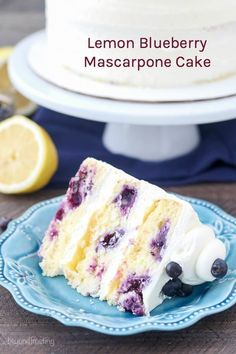 Tangy Lemon Blueberry Mascarpone Layer Cake is a moist lemon cake are loaded with sweet blueberries. In between each layer of cake is mascarpone whipped cream and a tangy lemon curd. It's an oil-based cake recipe that stays super moist and is dense like a sponge cake. #cake #layercake #blueberry #lemon #lemonblueberry #lemoncake #blueberrycake