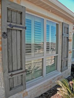 Antique blue, with iron accents. Antique blue, with iron accents. Wooden Shutters Exterior, Outside Shutters, Outdoor Shutters, Cedar Shutters, Diy Shutters, Homes With Shutters, Windows With Shutters, Wooden Window Shutters, Green Shutters