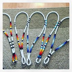 Working on a big order of lanyards - I don't think I have any duplicates. All have small differences in each lanyard Beaded Earrings Patterns, Beading Patterns, Beaded Jewelry, Beading Ideas, Beading Projects, Beaded Necklaces, Bead Earrings, Native Beadwork, Native American Beadwork