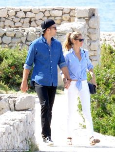 So romantic: The couple, who married in 2009, strolled the coastline holding hands...