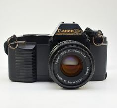 Vintage Canon T50 35mm Film SLR Camera w/ f1.8 50mm Canon FD Lens by vtgwoo on Etsy