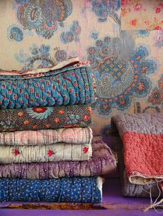 stack of vintage quilts