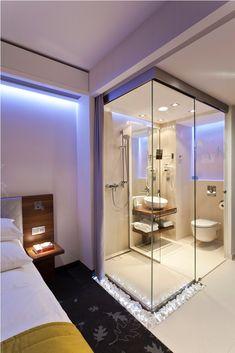 Glass-wall bathroom of PURO Hotel Wroclaw.