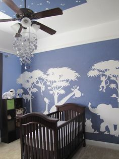 Heather Crandell did a beautiful job on this mural by painting it in a crisp white on a beautiful medium blue background. We love the stars they added on the ceiling too!