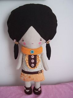 Cute big-headed doll. Love the hairstyle and the clothes.