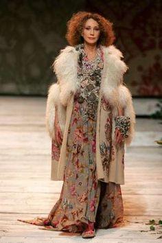 Marisa Berinson, age 59, walking the runway for Kenzo