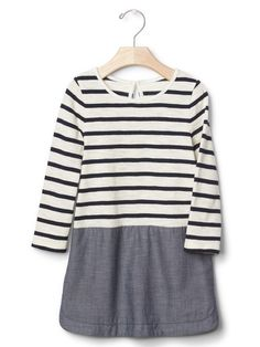 Gap. Normally I'd say avoid high contrast like these stripes but having your little girl in this and low contrast muted colors and minimal low contrast patterns for the rest of the family would totally let one of the kids be the star :)