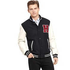 Tommy Hilfiger mens jacket. What we do best—the classic varsity jacket. Just as sporty as the collegiate variety but with a new school, sophisticated flair.• Classic fit.• 60% wool, 40% nylon.• Ribbed trim, snap closure, slash pockets, custom applique.• Dry clean.• Imported.