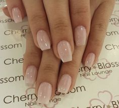Short natural looking acrylic nails; neutral color coffin shape summer design