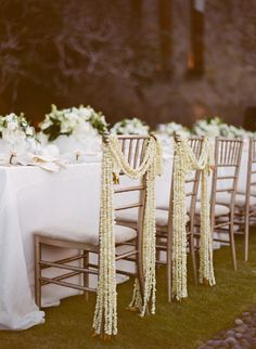 inspiration | garlands of tiny buds draped over chairs chair details | via: lisa vorce