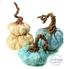 Sculpture artist Jessica Dvergsten's cream pumpkin topiary, antique blue and small teal paper mache pumpkin.