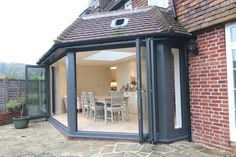 Our client chose Solarlux SL 60e Bi-Folding Doors with Solarlux SL 60e Tilt & Turn Windows and roof lantern in Slate Grey (RAL 7015).