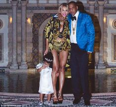 The Carter family: Beyonce shared this picture of her, Jay-Z and Blue Ivy as they celebrated New Year's Eve at the Versace mansion in Miami