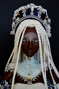 I like the wig, the hat, Maybe the clothes. But I am not in love with this doll's face.