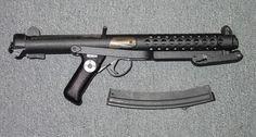 Sterling 9mm sub machine gun and curved magazine.