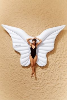 Shop FUNBOY Angel Wings Pool Float at Urban Outfitters today.