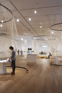 'Building: Inside Studio Gang Architects' Exhibition sub espacio hilo tension. neat idea for large scale display but to also divide space.