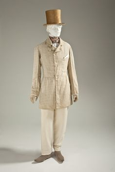 Man's Frock Coat, circa 1845, cotton plain weave with supplementary warp-float patterning, Europe via Los Angeles County Museum of Art.