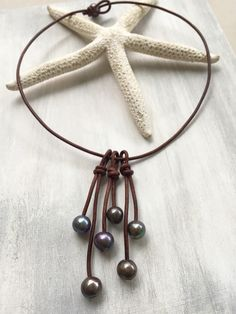 A personal favorite from my Etsy shop https://www.etsy.com/listing/262036369/leather-freshwater-pearls-tassel