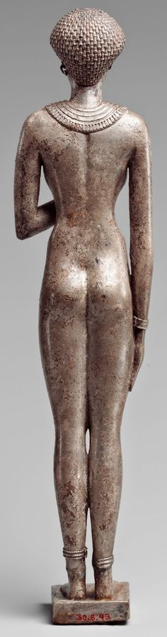 Silver statue of a royal woman (rear view) with the cartouches of Necho II on her arms, Egypt, 610–595 BC