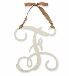 """Mud Pie Wooden Initial Wall Hanger - """"F"""" •Letter """"F"""" in Decorative Script •Wooden with Ivory Finish •Burlap Ribbon and Bow for Hanging •Display on Walls, Doors and Wreaths •Adds Elegance, Creativity, and a Personal Touch to Rooms, Nurseries, and Weddings •Displays Nicely Alone, or In a Combination of Letters •Measurements: 16.5"""" x 18"""" $28.95"""
