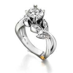 #172A 1CT - 14k white gold Mystic 1.15cttw floral diamond engagement ring designed by Mark Schneider. This engagement ring has a split shank and a floral design accented by round diamonds totaling .15