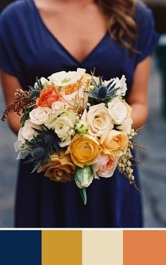 A gorgeous fall bouquet with navy blue, orange, yellow and cream. Source: Green Wedding Shoes