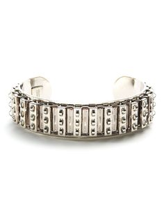 This silver cuff puts a micro spin on the studded trend with its rows of textured spikes  This is part of the Designer Pop-Up: Courtney Lee Collection