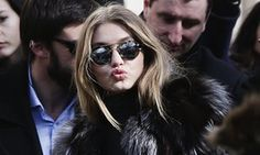 Gigi Hadid at Paris fashion week with round shades.