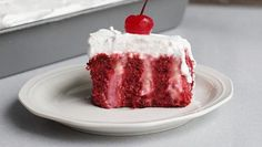 Red velvet cake mix, cheesecake pudding, and a little cherry flavored brandy make a fun twist on the classic poke cake dessert.
