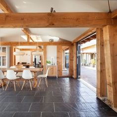 Interior to Exterior Courtyard Design in Douglas Fir Timber Framed Farmhouse