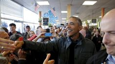 U.S. President Barack Obama greets patrons in Snow City Cafe in Anchorage, Alaska, September 1, 2015. Obama on Tuesday proposed a faster timetable for buying a new heavy icebreaker for the U.S. Arctic, where quickly melting sea ice has spurred more maritime traffic, and the United States has fallen far behind Russian resources.